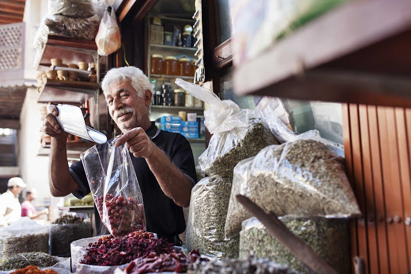 A local vendor measures some produce at the Spice Souk (market) in eastern Dubai.