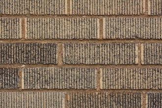 Photo: The classic brick-wall test, 200mm, 1/250 sec., F/8, ISO 500. Not bad vignetting, but pincushioning. It's very sharp across a wide patch of the center but softens toward the corners. zAll tests on Canon 5D Mark III.
