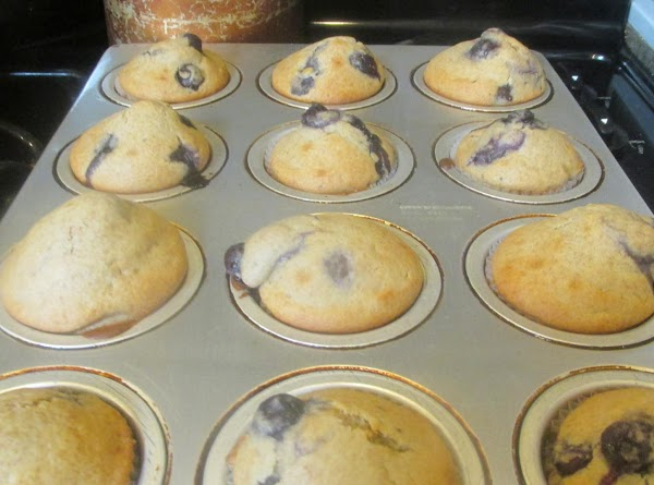 Place muffins in oven and bake in preheated 400 degree F. oven for 20...