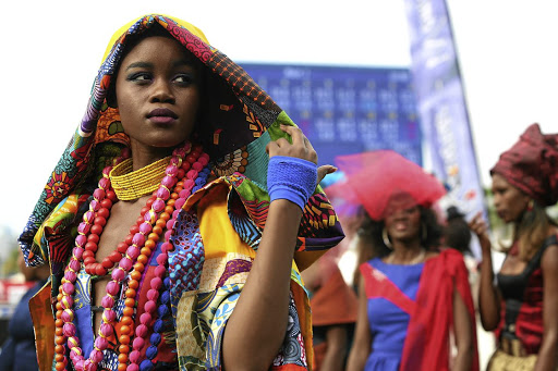 Colourful Samkelo Ndwandwe wearing designer Brenda Quin of Diva designs for the previous Durban July.