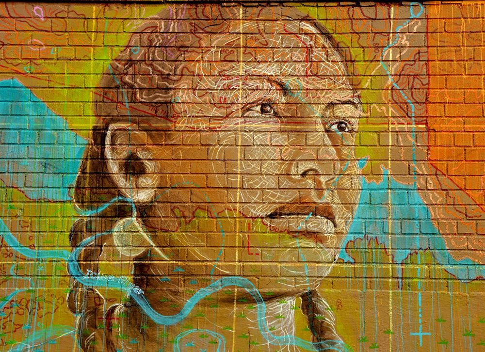 A mural in Queens, NY of our Decolonizer, Christine Nobiss, created by Lopi Laroe in honor of her work fighting the Dakota Access Pipeline in Iowa.