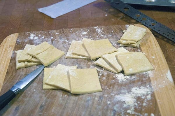 Cut the dough, into 2-inch (4cm) squares.