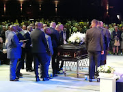 Former friends and colleagues of the late David Kekana carry his coffin during his memorial service in Randburg on August 28 2019.