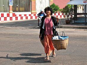 Photo: hawker heading for the market in Nakhon Phanom