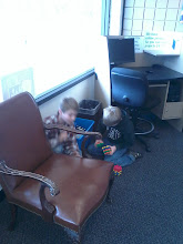 Photo: love the old style arm chair next to the computer station with toys tucked in between.