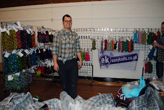 Photo: Mr Easyknits himself (and Roy peeking in to the picture too!) setting up his colorful stand!