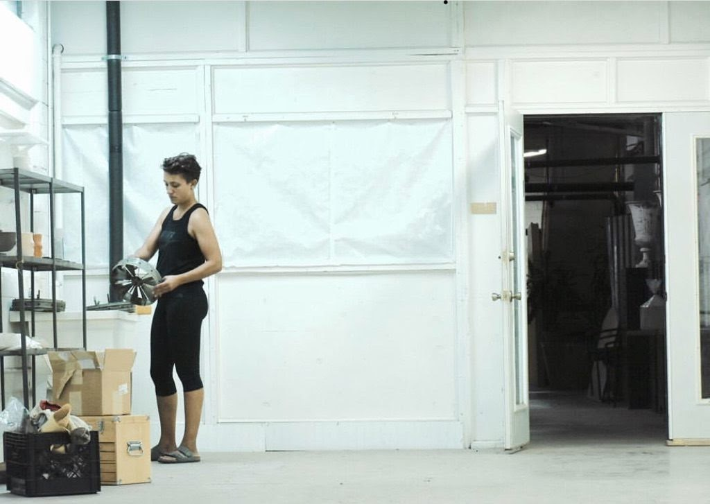 Studio spaces being renovated, person holding fan