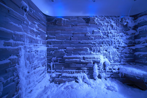 Norwegian-Escape-Snow-Room-blue - Norwegian Escape's Snow Room, featuring a flurry of powdery snow, is kept at a frosty 21 to 32 degrees F.