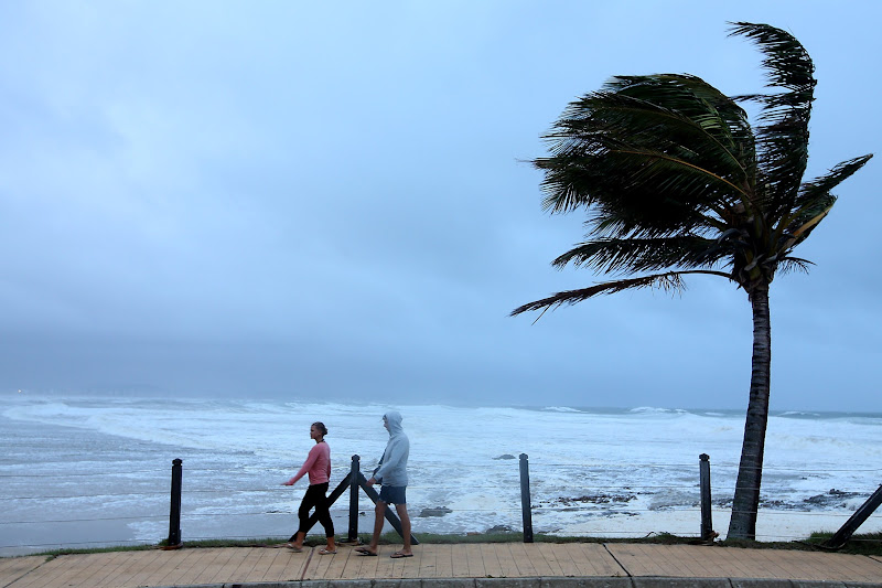 Photo: GOLD COAST, AUSTRALIA - JANUARY 28:  People walk during wild conditions at Snapper Rocks as Queensland experiences severe rains and flooding from Tropical Cyclone Oswald on January 28, 2013 in Gold Coast, Australia. Hundreds have been evacuated from the towns of Gladstone and Bunderberg while the rest of Queensland braces for more flooding.  (Photo by Chris Hyde/Getty Images)