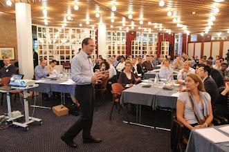 Photo: Futurist keynote speaker Patrick Dixon on platform giving keynote at corporate event