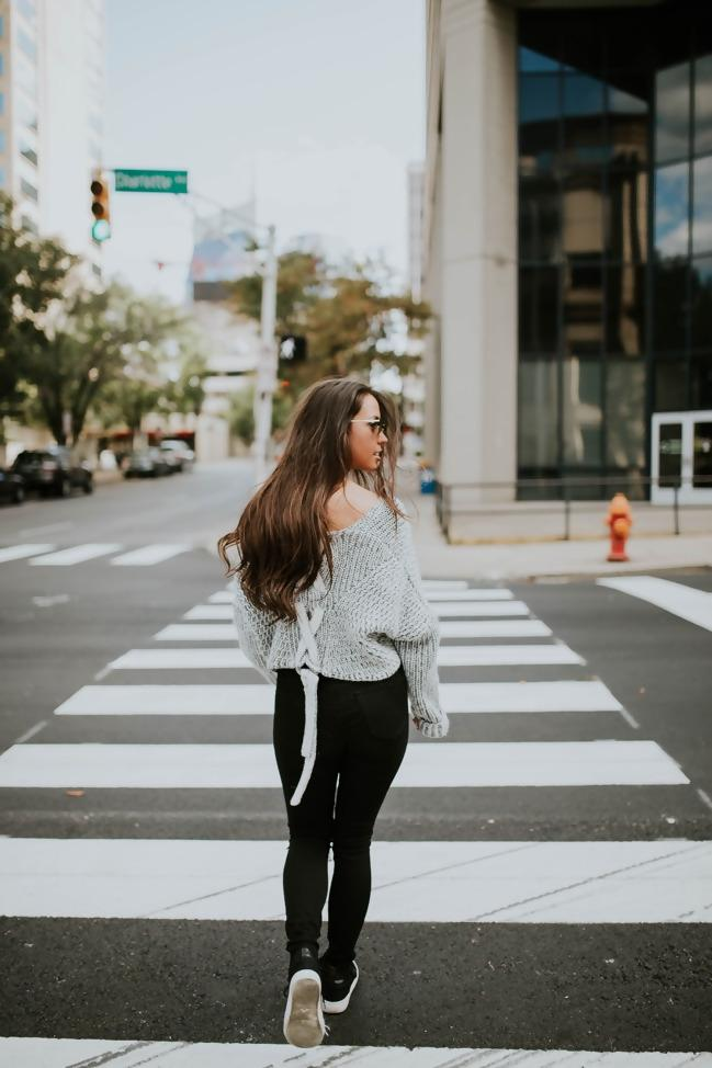 A person walking down a city street  Description automatically generated