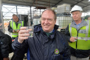 Cape Town deputy Mayor Ian Neilson tests the water during a site visit to Cape Town's first desalination plant.