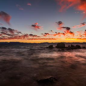 Lake Tahoe Sunset by Rajarshi Chowdhury - Landscapes Sunsets & Sunrises ( water, california, lake, landscape, usa, burning sky, sky, nature, sunset, nevada, tahoe, long exposure, rocks, lake tahoe )