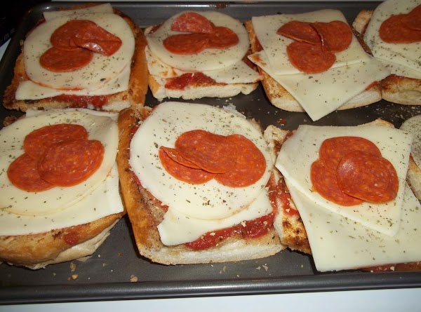 Add three pieces of pepperoni to each slice.Bake for 10 - 15 minutes or...