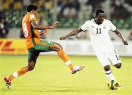 BATTLE: Ivory Coast's Kader Abdul Keita and Ghana's Sulley Muntari tussle in the third place playoff. PIc. Lefty Shivambu. 09/02/08. © Gallo Images.