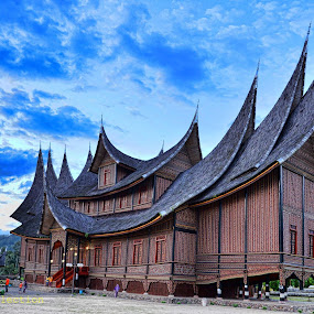 Pagaruyung was the seat of the Minangkabau kings of Western Sumatra, though little is known about it. Modern Pagaruyung is a village in Tanjung Emas subdistrict, Tanah Datar regency, located near the town of Batusangkar, Indonesia. A building was built in 1976 to represent the original Pagaruyung palace, and open to the public as a museum and tourist attraction. It was built in the traditional Minangkabau Rumah Gadang architectural style, but had a number of atypical elements including three stories. The palace was destroyed by fire on the evening of February 27, 2007 after the roof was struck by lightning. Now the goverment build the new replica of the palace. by Fathar Alex - Travel Locations Landmarks