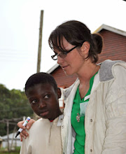 Photo: Ms. Tracie helping one of the boys settle in.