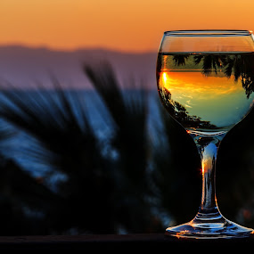 white wine on the sunset sea background by Grigor  Ivanov - Landscapes Sunsets & Sunrises ( reflection, ocean, yellow, beach, travel, restaurant, party, sun, mountains, sky, nature, drink, glass, light, wine, water, abstract, orange, beautiful, white, romantic, sea, holiday, palm tree, blue, sunset, background, white wine, scene, summer, cloud, night, bar )