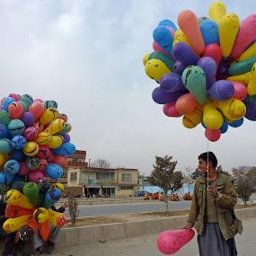 Kabul balloon sellers by Eason Jordan - Landscapes Travel