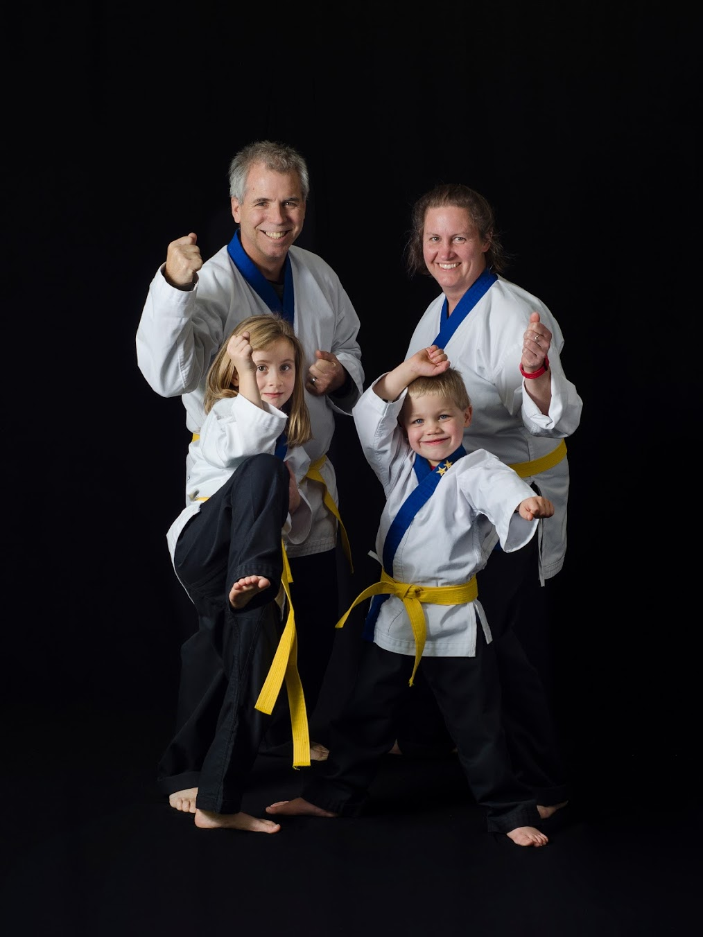 Parents doing karate with their kids