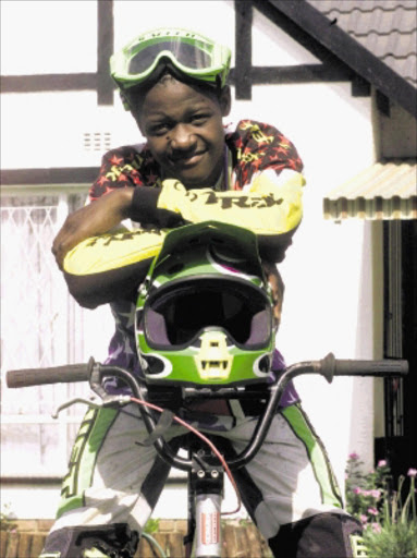 hot SHOT: National BMX champion Sifiso Nhlapo. Pic: WATSON MCOTELI. 11/02/2002. © Sowetan.  SW20020111WMC002:SPORT:OTHER:11JAN2002 - 11012002WMC SPORT Sifiso Nhlapo, 14, won the South African National BMX Championship in his age group. PHOTO:WATSON MCOTELI