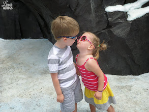 Photo: Unedited photo. I LOVE how they are holding hands and the photo is sharp enough to see that Lyla's eyes are closed under her sunglasses. I took this picture at Sea World, then while we were waiting in line, I transferred it to my camera and uploaded it to Instagram and Facebook.