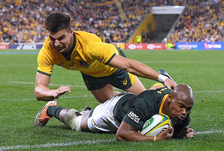 Australia's Jack Maddocks fails to stop South Africa's Makazole Mapimpi from scoring a try during the Rugby Championship match at the Suncorp Stadium in Brisbane on September 8, 2018.