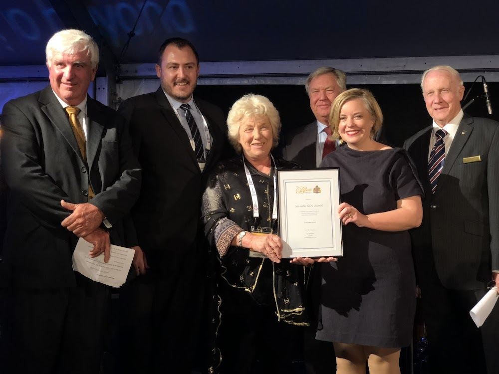 The mayor Cathy Redding accepts the A R Bluett Award from NSW Local Government Association president and City of Sydney deputy Lord Mayor, Cr Linda Scott, with from left,  Bluett Trustee Mike Montgomery AM, Narrabri shire  general manager Stewart Todd, Bluett Trust chair Les McMahon, and Trustee Allan Ezzy.