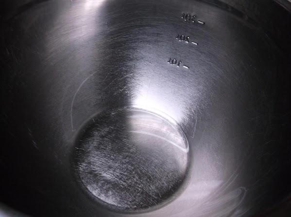 Oil a large bowl.