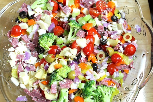 In a LARGE mixing bowl start adding all of your chopped up vegetables, add...