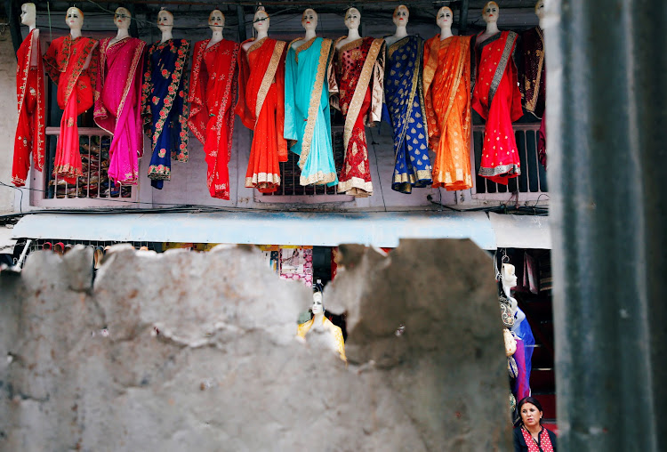 Mannequins are displayed outside a clothing shop in Kathmandu, Nepal.