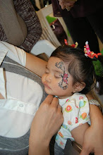 Photo: Baby face painting by Bella the Clown at a 1 year old Birthday party! Call to book Bella today at 888-750-7024