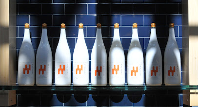Photo: Bottles of Sake line the walls as decorative backdrops at the Japanese restaurant, Shoyu located on Concourse G at the Minneapolis St. Paul airport on September 5, 2012. The airport has three spots designed to make waiting for your plane, enjoyable including,  Mimosa, Shoyu and Minnebar. (Pioneer Press: Ginger Pinson)