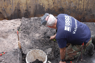 Photo: Farr troweling  through 6,000 year old sediments.