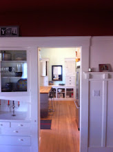Photo: The two tall cabinets you see on the back wall of the kitchen, framing the mirror, are the original cabinets in the old farmhouse. We saved them and built a new base for them to integrate them into the new kitchen.