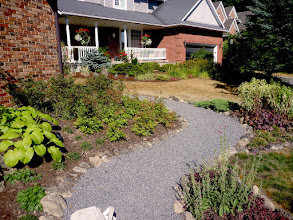 Photo: Permeable granite gravel looks great and is more eco-friendly than impervious surfaces.