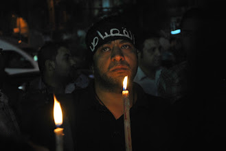Photo: Many assembled for the vigil could not conceal their grief.