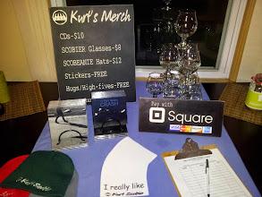 Photo: Merch setup. www.kurtscobie.com/buy