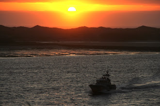 Photo: The US Coast Guard coming in at sunset after a day at sea...