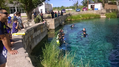 """Photo: August 10-Santa Rosa, NM has a curious natural spring called """"Blue Hole"""".  Its waters are pristine and reach an eighty foot depth!  It is a hub for scuba divers to learn and practice."""