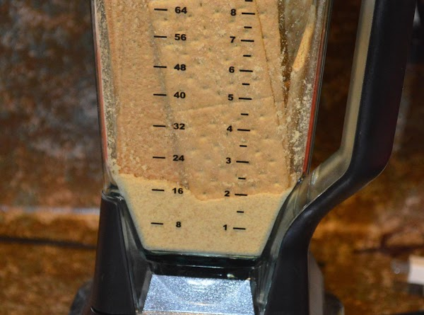 in a blender crush 2 packages of graham crackers