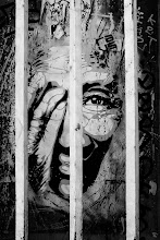 Photo: Trapped behind bars, this unknown face seems to dislike what he sees outside ... all those inequalities !  just thinking about it  #streetartsunday  #streetphotography  #fujigirl
