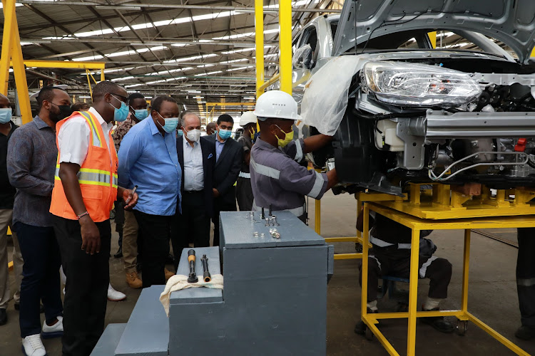 Governor Hassan Joho, Moses Aviero of Associated Vehicle Assemblers, President Uhuru Kenyatta, Simba Corp Group executive chairman Adil Popat, CEO Dinesh Kotecha and AVA Technician Reuben Mwaniki at AVA plant on Thursday.