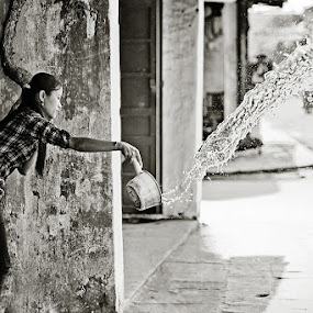 Cool wet streets of Hoi An by Thomas Jeppesen - People Street & Candids ( monochrome, b&w, girl, thomasjeppesen, black and white, bw, vietnamese, subsignal, vietnam, photography )