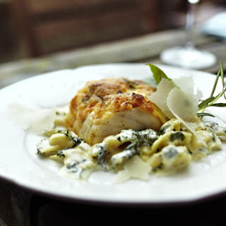 Baked Cheesy Cod with Ravioli and Spinach.