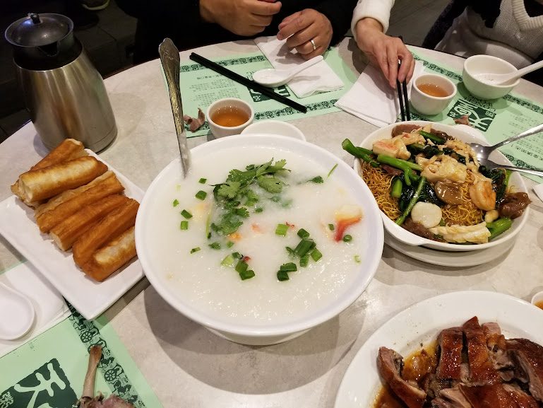 Congee, breadsticks, and fried noodles with seafood