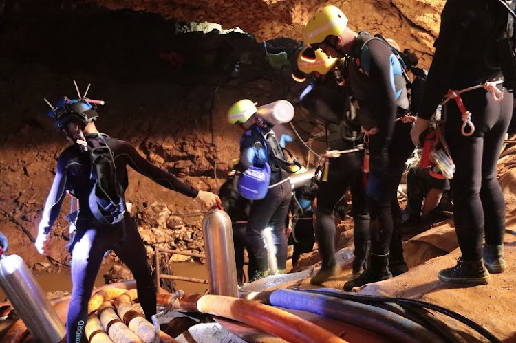 This undated handout photo taken recently and released by the Royal Thai Navy on July 7, 2018 shows a group of Thai Navy divers in Tham Luang cave during rescue operations for the 12 boys and their football team coach trapped in the cave at Khun Nam Nang Non Forest Park in the Mae Sai district of Chiang Rai province.