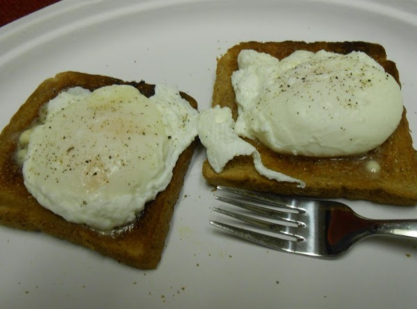 NOTE: The addition of vinegar to the water helps the whites of the eggs...
