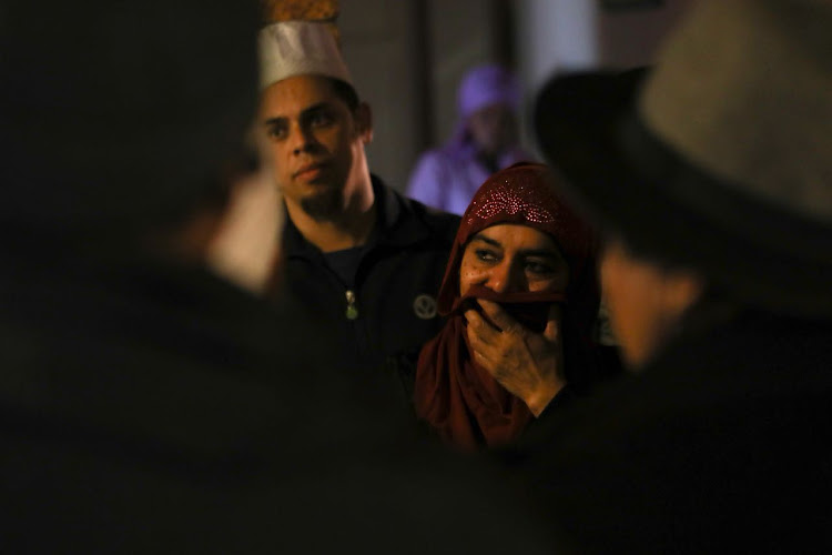 Zainab Bassa reacts in the wake of the murder of her husband, Ismail Bassa, at the Malmesbury mosque in the Western Cape on June 14 2018.