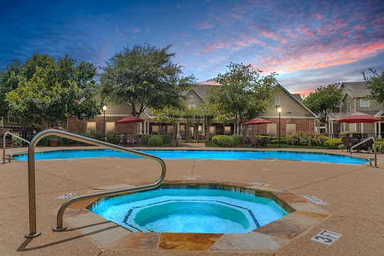 Residence at the Oaks apartment swimming pool at dusk